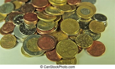 Coins on the table. Close up, rotation shot