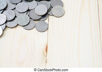 coins on wooden background