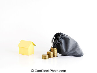 Coins stack and money bag with house paper for Home Loans concept