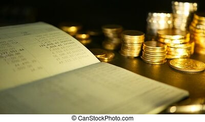 Coins stack and saving bank account passbook.concepts for mortgage and real estate investment, for saving or investment