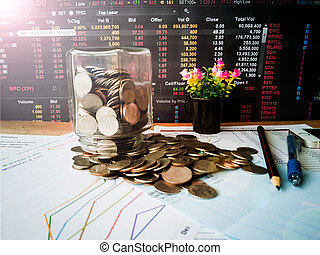 Coins that flow out of the bottle, the concept of financial growth and investment profits with investor planning