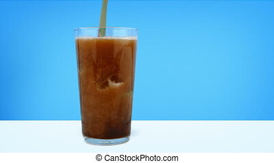 Coke Poured Into Glass With Ice Cubes - Delicious coke drink...