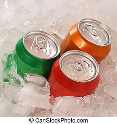 Cola and lemonade beverages in cans on ice