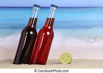 Cola and lemonade soda drink on the beach