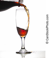 Cola in glass on white background