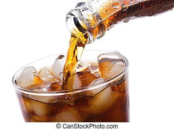 Cola is pouring into glass on white background
