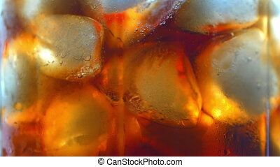 Cola with ice cubes background. Cola with Ice and bubbles in glass. Food background. Stock full HD video footage 4K