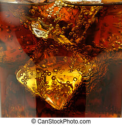 cola with ice cubes , close up