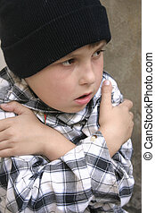 Cold and alone - A homeless boy cold and lonely Part of a...