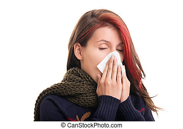 Portrait of a girl in winter clothes blowing her nose