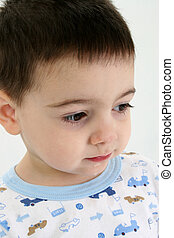 Cold and Flu Season - Toddler boy in pajamas with runny nose...