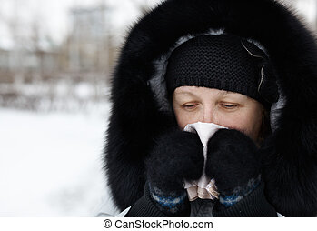 cold and flu - woman blowing nose and sneezing , winter cold...