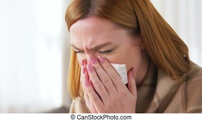 cold and health problem concept - sick woman in blanket coughing at home