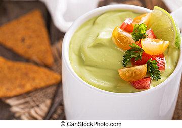 Cold avocado soup with tomato salsa