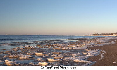 Cold Baltic sea in winter with icy beach