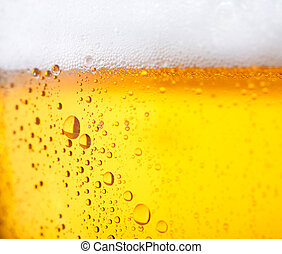 Cold beer - Fresh beer with froth and condensed water pearls