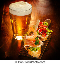 Cold beer with gourmet appetizers