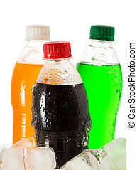 cold bottles of soda in ice on white background