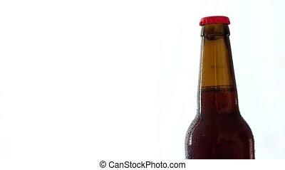 brown bottle of beer - Cold brown bottle of beer rotating...