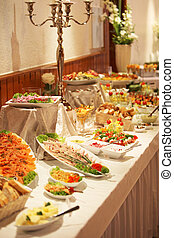 Cold buffet display with an assortment of salads,...