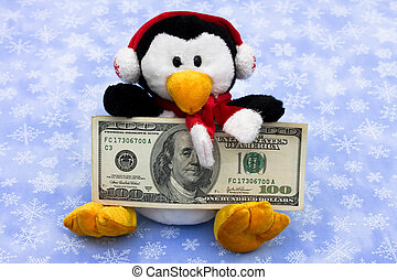 Cold Cash for Christmas - A penguin holding a one hundred...
