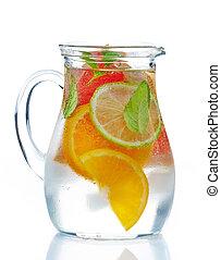 cold citrus fruit drink - jug of cold nonalcoholic citrus...