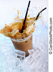Cold coffee drink with ice and splashes