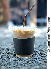 Cold coffee in plastic cup