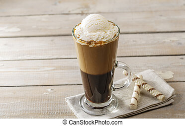 cold coffee with ice cream in a glass