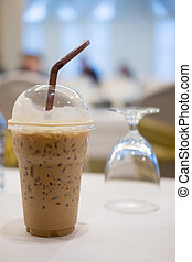 Cold coffee with ice in take away cup