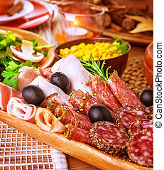 Cold cuts - Closeup on cold cuts in centerpiece of table,...