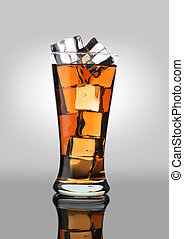 Cold Drink Cola Soda Soft Drink in a Glass with Ice Cubes