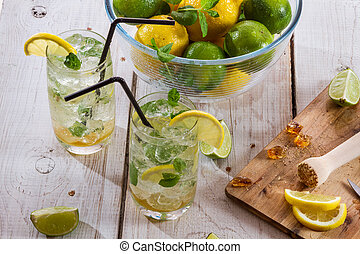 Cold drink with fresh citrus fruit