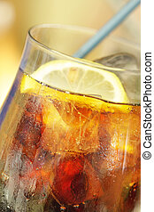 Cold drink with lemon and ice