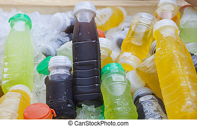 cold drinking fruit juice beverage in ice cooler