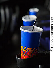 Cold Drinks In Armrests At Theater - Disposable cold drink...