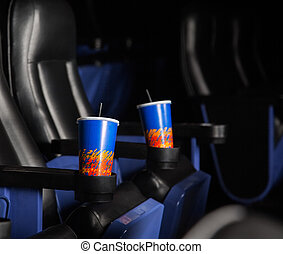 Cold Drinks In Armrests Of Seats At Theater