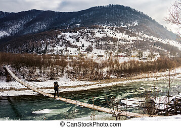 cold flow of river in snowy mountains. ice and snow on the...
