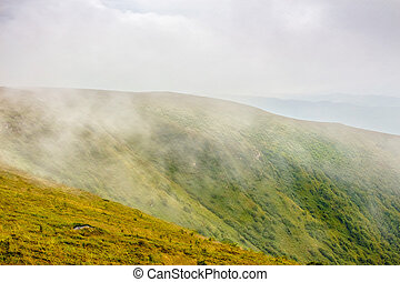 cold fog on hot sunrise in mountains - cold morning fog on...