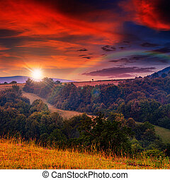 cold fog on hot sunset in mountains