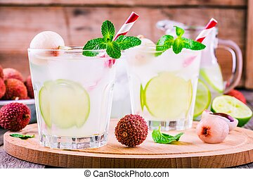 Cold fresh lemonade with lychee, lime and mint in glass