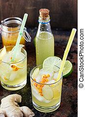 Cold ginger lemonade with lime and lemon.