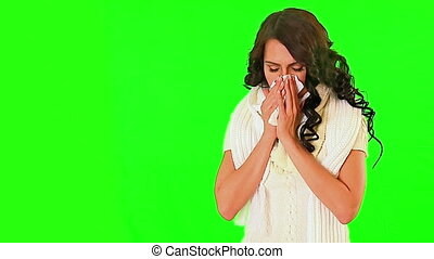 Cold girl blowing his nose on green screen. Cold girl with...