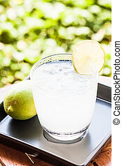 Cold glass of lime juice soda with lime