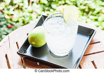 Cold glass of lime juice with lime