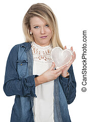 Cold Hearted Woman - Woman holding a heart made of ice