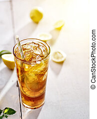 cold iced tea with lemons and copy space composition.