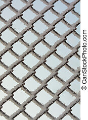 Cold icy metal fence