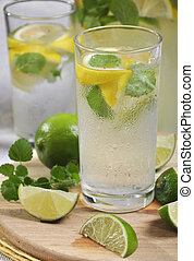 lemonade in glass - Cold lemonade in glass with ice, lime ...