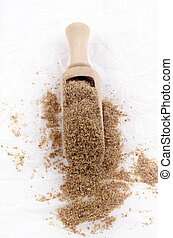 cold milled organic flaxseed on white paper